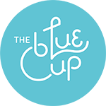 Бариста у The Blue Cup Coffee Shop